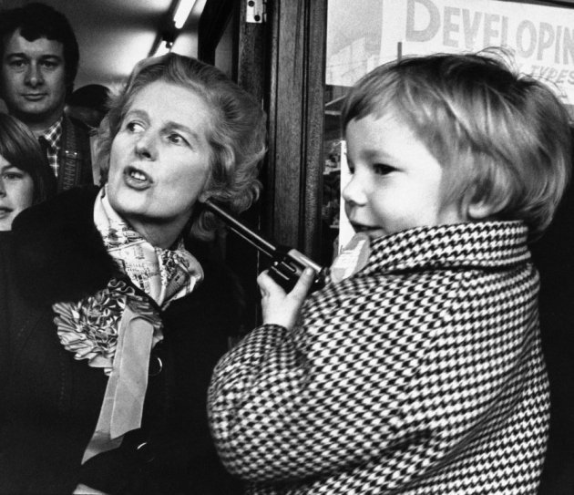 then-conservative-party-leader-margaret-thatcher-chats-with-a-gun-toting-four-year-old-in-1976