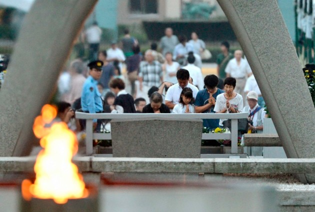 People pray for the victims of the 1945 atomic bombing, in the Peace Memorial Park in Hiroshima