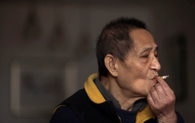 File photo of Bao, a former member of the Central Committee of the Communist Party of China, smoking at home during an interview in Beijing