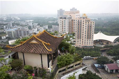 A privately-built illegal temple-like structure is seen on the top of a 20-storey residential block in the southern Chinese city of Shenzhen