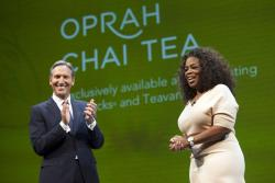 Howard Schultz announces the new Teavana Oprah Chai Tea with Oprah Winfrey during the company's annual shareholders meeting in Seattle